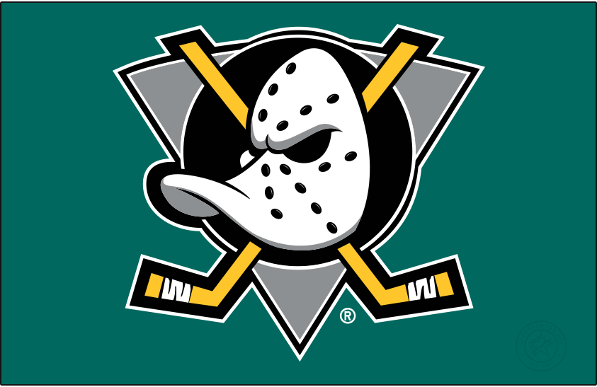 Mighty Ducks of Anaheim Logo Primary Dark Logo (1993/94-2005/06) - When used on a dark background, as it is shown here on jade green, the original Mighty Ducks of Anaheim logo featured a duck-billed goalie mask on a grey (not jade) triangle, black circle, and two crossed hockey sticks. The Mighty Ducks used this logo from 1993 through 2006 when the team's name was shortened to just Ducks. SportsLogos.Net