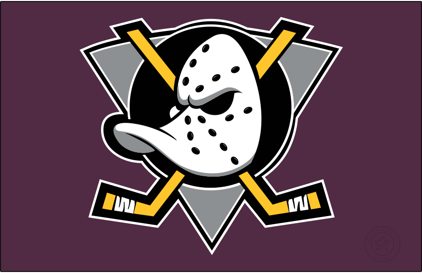 Mighty Ducks of Anaheim Logo Jersey Logo (1999/00-2005/06) - Duck goalie mask on grey triangle on eggplant, worn on the Mighty Ducks of Anaheim road jersey.  Shade of eggplant adjusted from previous version SportsLogos.Net