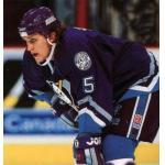 Mighty Ducks of Anaheim (1997) Ruslan Salei wearing Mighty Ducks of Anaheim road purple uniform during 1996-97 season