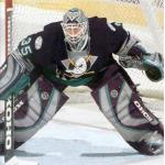 Mighty Ducks of Anaheim (2004) JS Giguere wearing Mighty Ducks of Anaheim home purple uniform during 2003-04 season
