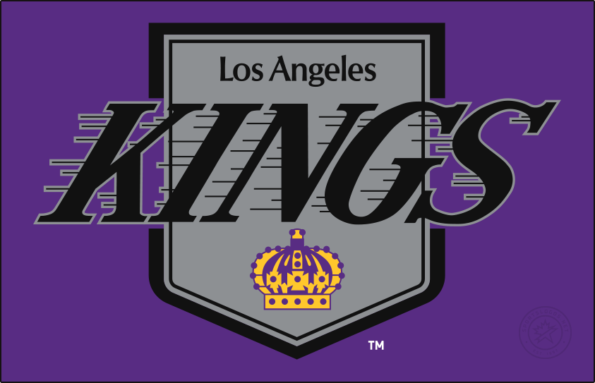 Los Angeles Kings Logo Primary Dark Logo (1987/88) - A one year wonder, the Los Angeles Kings began their transition to black and silver a year before going all in with this recoloured version of their previous logo. Black and silver took over most of the design with the team lettering and the royal pennant both now entirely with the new hues, the only remnant of the purple and gold came via the crown at the bottom of the shield. The team retained purple and gold as their uniform colours during this season. SportsLogos.Net