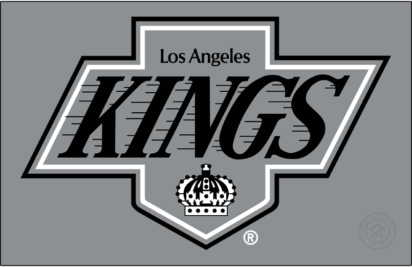 Los Angeles Kings Logo Primary Dark Logo (1988/89-1997/98) - Upon their introduction of Wayne Gretzky, the Los Angeles Kings also unveiled their new logo, uniforms, and colour scheme. Taking a page from the cross-town Los Angeles Raiders of the NFL, the Kings adopted a black and silver look while updating the logo slightly -- the team script now also enclosed within the shape of the original Kings pennant design. Often referred to as the Chevrolet logo by fans due to its similarity in shape to the car company logo. SportsLogos.Net