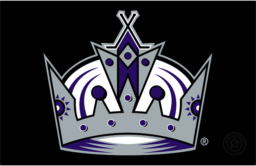 Los Angeles Kings Logo Primary Dark Logo (2002/03-2010/11) - Looking to simplify their primary brand, the Los Angeles Kings dropped their coat of arms logo to secondary status and promoted their previous secondary logo. This logo featured just the crown, still purple, black, and silver. The top of the crown featured two crossed hockey sticks as well as two purple suns on either side. SportsLogos.Net