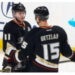 Anaheim Ducks (2013) Saku Koivu and Ryan Getzlaf wearing Anaheim Ducks home black uniform during 2012/13 season