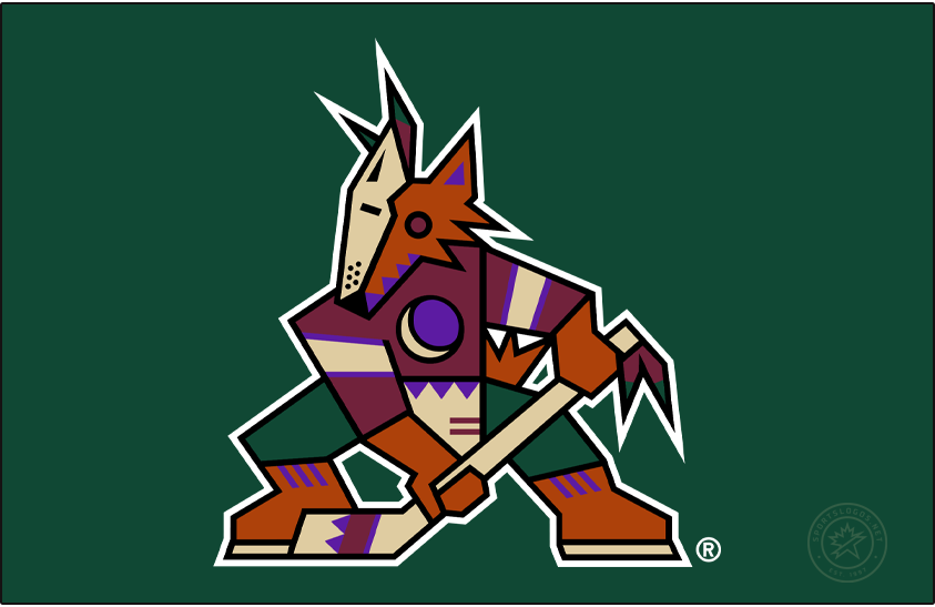 Phoenix Coyotes Logo Primary Dark Logo (1999/00-2002/03) - Known as the Kachina Coyotes logo, the Phoenix Coyotes used this logo from their first season in Arizona in 1996-97 through 2002-03. The logo shows a coyote in the style of a kachina doll, wearing half a mask, holding a hockey stick, and a crescent moon on its chest. This version of the logo, shown here on green without the team name, was adopted as their official primary logo for the 1999-2000 NHL season. SportsLogos.Net