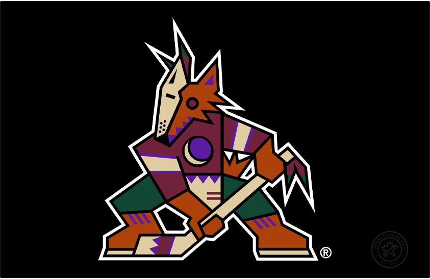 Phoenix Coyotes Logo Primary Dark Logo (1999/00-2002/03) - Known as the Kachina Coyotes logo, the Phoenix Coyotes used this logo from their first season in Arizona in 1996-97 through 2002-03. The logo shows a coyote in the style of a kachina doll, wearing half a mask, holding a hockey stick, and a crescent moon on its chest. This version of the logo, shown here on black without the team name, was adopted as their official primary logo for the 1999-2000 NHL season. SportsLogos.Net