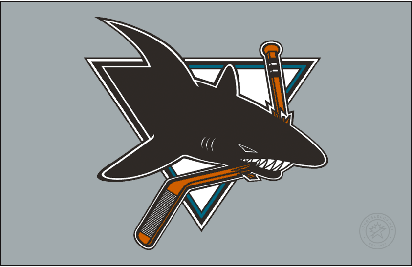 San Jose Sharks Logo Jersey Logo (2020/21-Pres) - The San Jose Reverse Retro logo, a throwback to the 1998 season with the Sharks logo of the era - a black shark chomping on a hockey stick within a triangle now worn on a silver or grey jersey. SportsLogos.Net