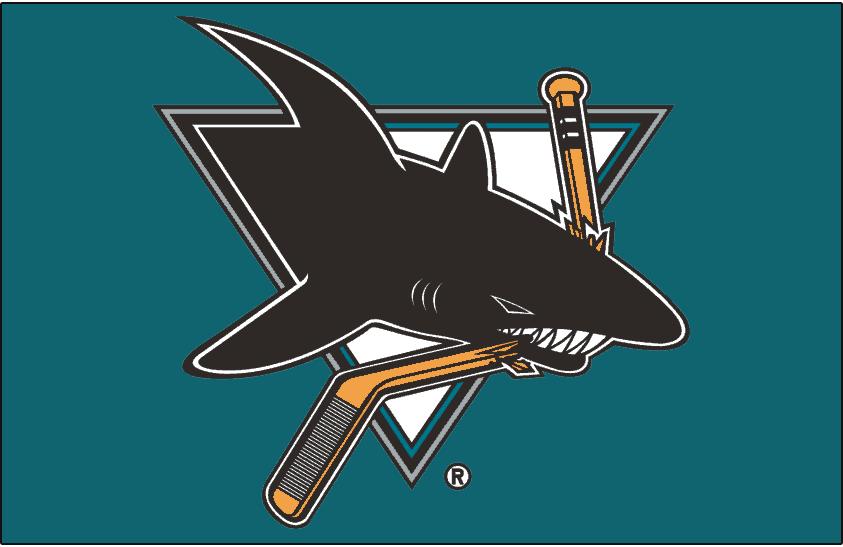 San Jose Sharks Logo Jersey Logo (1991/92-1997/98) - Worn on front of San Jose Sharks road teal jersey from 1991-92 inaugural season until 1997-98. Hockey stick colour changed for 1998-99 season SportsLogos.Net