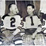 Boston Bruins (1937) Eddie Shore and Tiny Thompson wearing Boston Bruins uniforms during 1936-37 season
