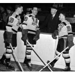 Boston Bruins (1945) Milt Schmidt, Porky Dumart, Bobby Bauer, and manager Art Ross with the Boston Bruins in 1944-45 season