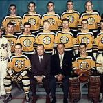 Boston Bruins (1959) Boston Bruins players pose for a team photo wearing their yellow home jerseys during the 1958-59 season