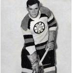 Boston Bruins (1949) Ed Kryznowski in the Boston Bruins 25th anniversary white sweaters in 1948-49 (note the 24 and 49, symbolising 1924-1949 on either side of the B in the logo).  This is the first appearance of the famous spoked B Bruins logo in their history.