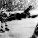 Boston Bruins (1970) Bobby Orr wearing the Boston Bruins black uniform during the 1969-1970 Stanley Cup Final, celebrating his Cup winning goal while flying through the air
