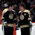 Boston Bruins (1974) Phil Esposito and Bobby Orr wearing the Boston Bruins black uniforms with 50th anniversary patch during the 1973-74 season