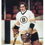 Boston Bruins (1977) Gilles Gilbert wearing the Boston Bruins white uniform, first season with the Bear shoulder patch, during the 1976-77 season