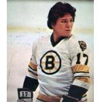 Boston Bruins (1977) Stan Jonathan wearing the Boston Bruins white uniform, first season with the Bear shoulder patch, during the 1976-77 season