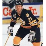 Boston Bruins (1993) Ted Donato wearing Boston Bruins road black jersey with Stanley Cup 100th Anniversary patch during 1992-93 season
