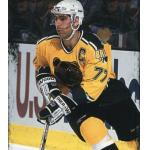 Boston Bruins (1996) Ray Bourque wearing Boston Bruins gold alternate uniform with white helmet during 1995-96 season