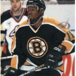 Boston Bruins (1997) Anson Carter wearing Boston Bruins black road uniform during 1996-97 season