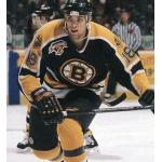 Boston Bruins (1999) Kyle McLaren wearing Boston Bruins road black uniform with Bruins 75th Anniversary patch during 1998-99 season