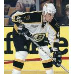Boston Bruins (2000) Johnathan Aitken wearing Boston Bruins home white uniform with NHL 2000 patch during 1999-2000 season