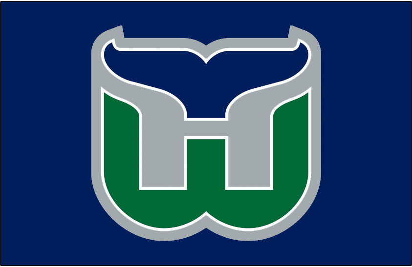 Hartford Whalers Logo Jersey Logo (1992/93-1996/97) - Green W outlined in white with navy blue whale tail above, H for Hartford formed in between the two in silver. Worn on Hartford Whalers road navy blue jersey from 1992-93 until their final season in 1996-97 SportsLogos.Net
