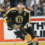 National Hockey League (2000) Ray Bourque wearing Boston Bruins road black uniform with NHL 2000 patch during 1999-2000 season
