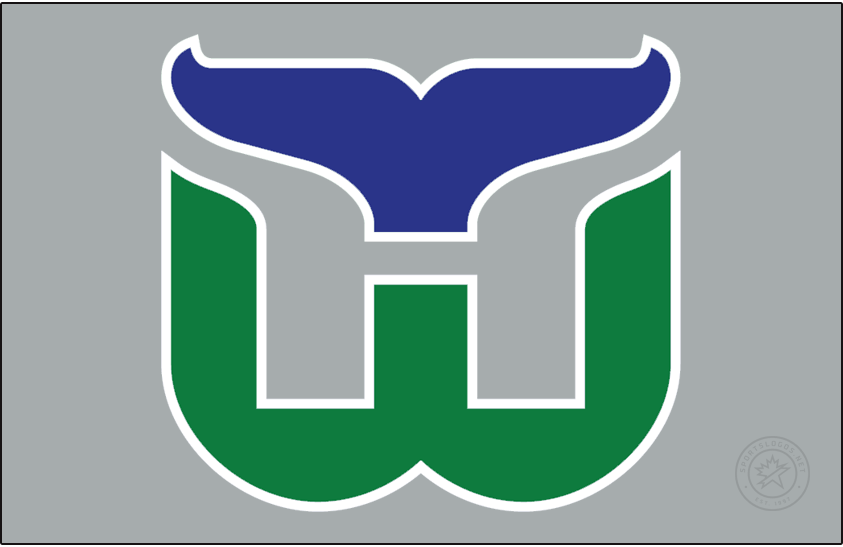Carolina Hurricanes Logo Jersey Logo (2020/21-Pres) - The Carolina Hurricanes Reverse Retro logo, a throwback to the 1979 season when the club played as the Hartford Whalers. The design features the Whalers classic logo of a green W below a blue whale tail with an H formed in the negative space between. For the Reverse Retro series this logo appears on a silver jersey. SportsLogos.Net