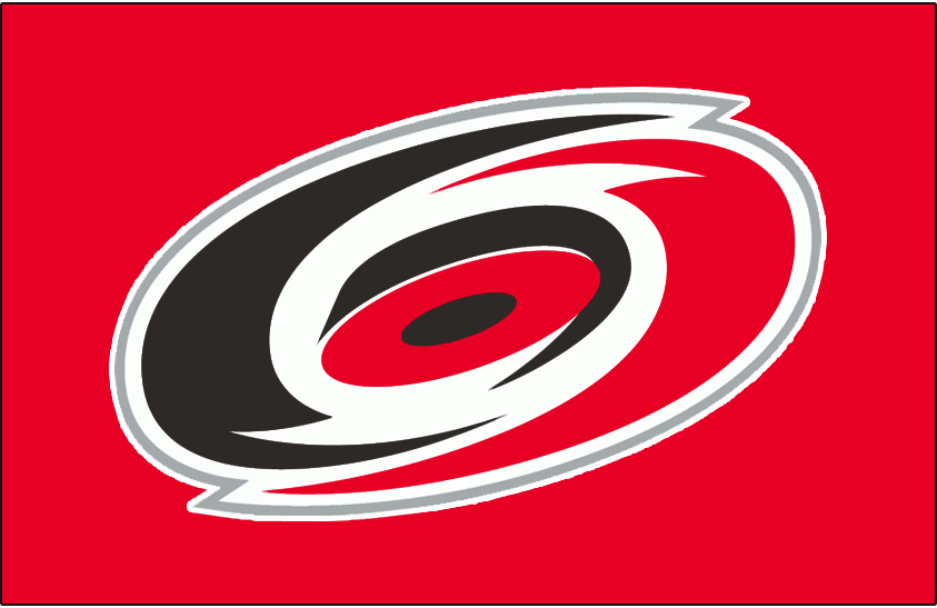Carolina Hurricanes Logo Jersey Logo (1997/98-1998/99) - A red, black, and silver overhead view of a hurricane on red. Worn on the Carolina Hurricanes red road jerseys from 1997-98 through 1998-99. Shade of red was darkened considerably for the 1999-2000 season SportsLogos.Net