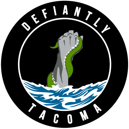 Tacoma Defiance Logo Alternate Logo (2019-Pres) - A silver fist punching up through the waves grasping a green sea creature inside a black circle with Defiantly Tacoma written inside SportsLogos.Net