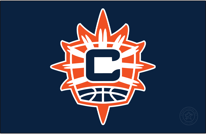 Connecticut Sun Logo Alt on Dark Logo (2021-Pres) - In 2021, the Connecticut Sun altered their entire identity to be based upon their previous alternate logo, but with some tweaks. The logo shows a navy blue C on an orange and blue shield with the rays of the sun shining behind it, at the bottom of the shield is the top of a basketball in blue and white. SportsLogos.Net