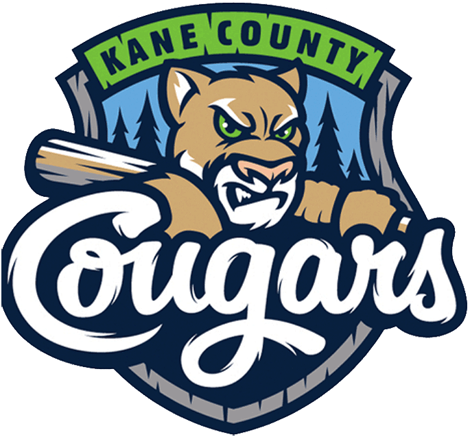 Kane County Cougars Logo Primary Logo (2021-Pres) - When the Kane County Cougars transferred from the Midwest League to the American Association they retained the same logo they had used since 2016. The logo shows a beige cougar holding a baseball bat over its shoulder in front of a forest landscape on a grey and blue shield. KANE COUNTY is arched above in blue and lime green and Cougars is scripted across the front in white. SportsLogos.Net
