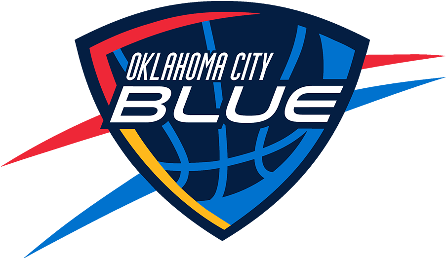 Oklahoma City Blue Logo Primary Logo (2014/15-2015/16) - The Oklahoma City Blue logo is designed to closely resemble that of their NBA affiliate the Oklahoma City Thunder. It features the team name in white italics on a navy blue shield, within the shield is a light blue basketball with red-orange and yellow shading. Outside the shield are red-orange and light blue streaks. The Blue dimmed the shade of red-orange used on this logo following the 2015-16 season. SportsLogos.Net