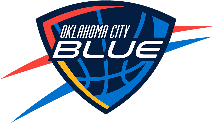 Oklahoma City Blue Logo Primary Logo (2016/17-Pres) - The Oklahoma City Blue logo is designed to closely resemble that of their NBA affiliate the Oklahoma City Thunder. It features the team name in white italics on a navy blue shield, within the shield is a light blue basketball with sunset red and yellow shading. Outside the shield are sunset red and light blue streaks. The Blue dimmed the shade of red used on this logo in time for the 2016-17 season. SportsLogos.Net