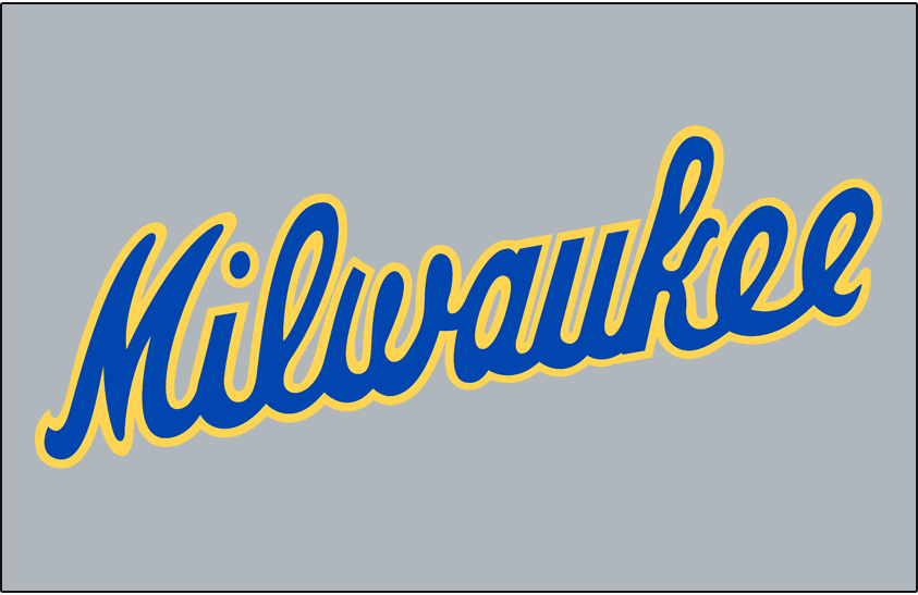 Milwaukee Brewers Logo Jersey Logo (1986-1989) - Milwaukee scripted diagonally in blue and yellow on grey, worn on Brewers road jersey from 1986 until 1989 SportsLogos.Net