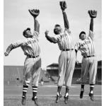 Boston Red Sox (1940) Bobby Doerr, Ted Williams, and Dom DiMaggio leap while wearing the Boston Red Sox road uniform in 1940