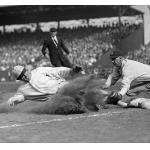 Boston Red Sox (1925) A Boston Red Sox player wearing the home uniform slides into third base against the New York Yankees during the 1925 season