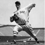 Boston Red Sox (1934) Lefty Grove warming up prior to a game wearing a Boston Red Sox home uniform in 1934
