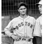Boston Red Sox (1937) Bobby Doerr poses wearing the Boston Red Sox road uniform before a game in 1937