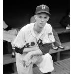 Boston Red Sox (1951) Micky McDermott wearing the Boston Red Sox home uniform with American League 50th anniversary patch during a game in 1951