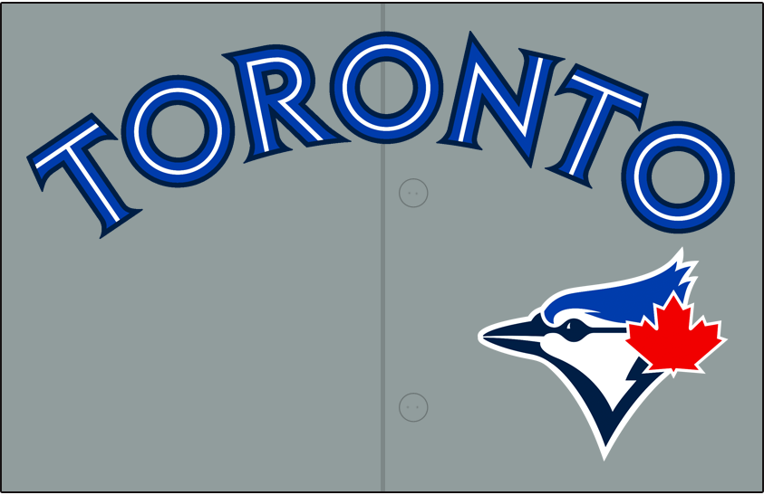 Toronto Blue Jays Logo Jersey Logo (2014-2019) - Toronto in blue and white spilit lettering with a navy blue outline on grey, blue jay head logo below and to the (player's) left. Worn on Toronto Blue Jays road uniform beginning with the 2014 season. SportsLogos.Net