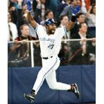 Toronto Blue Jays (1993) Joe Carter celebrates after hitting World Series winning home run wearing Toronto Blue Jays home uniform in 1993