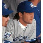 Toronto Blue Jays (1996) Pat Hentgen in the dugout wearing Toronto Blue Jays road uniform with Blue Jays 20th anniversary patch in 1996