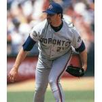 Toronto Blue Jays (1997) Roger Clemens on the mound wearing the Toronto Blue Jays road uniform with Jackie Robinson 50th Anniversary patch on sleeve in 1997