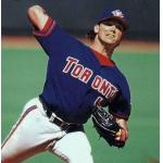 Toronto Blue Jays (1997) Pat Hentgen throwing a pitch wearing the Toronto Blue Jays alternate uniform on the road in 1997