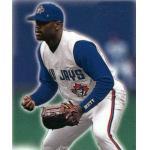 Toronto Blue Jays (1999) Carlos Delgado in the field wearing the Toronto Blue Jays sleeveless home alternate jersey in 1999