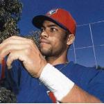 Toronto Blue Jays (1999) Jose Cruz Jr signs autographs while wearing the Toronto Blue Jays batting practice uniform during spring training in 1999