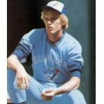 Toronto Blue Jays (1979) Jerry Garvin sits on the steps of the dugout while wearing the Toronto Blue Jays road uniform in 1979