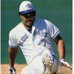 Toronto Blue Jays (1990) George Bell slides into third base while wearing the Toronto Blue Jays home uniform in 1990
