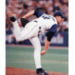 Toronto Blue Jays (2001) Roy Halladay throws a pitch wearing the Toronto Blue Jays home sleeveless alternate uniform during a game in 2001